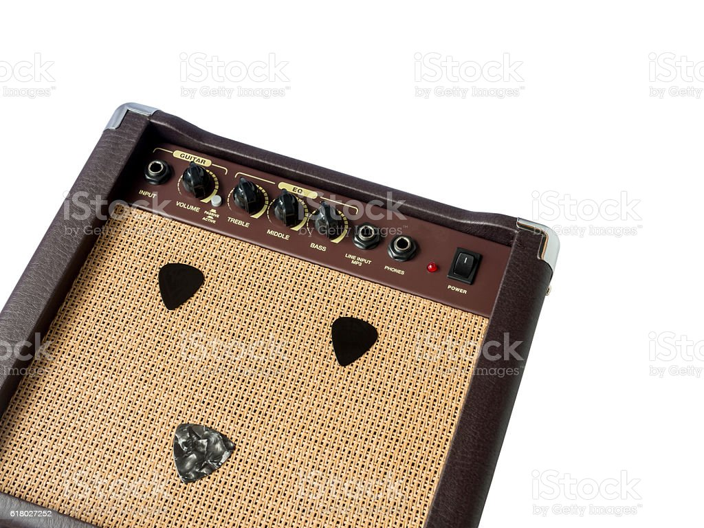 Small acoustic guitar amplifier with pick guitar on amplifier ma stock photo