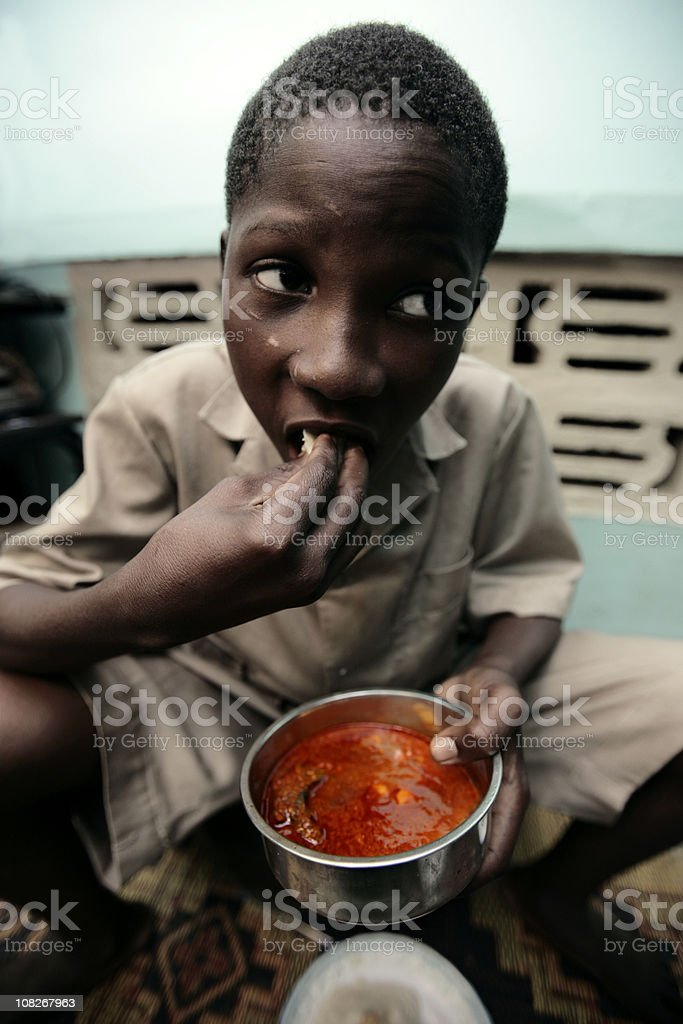 Small African Boy Eating Traditional Food stock photo