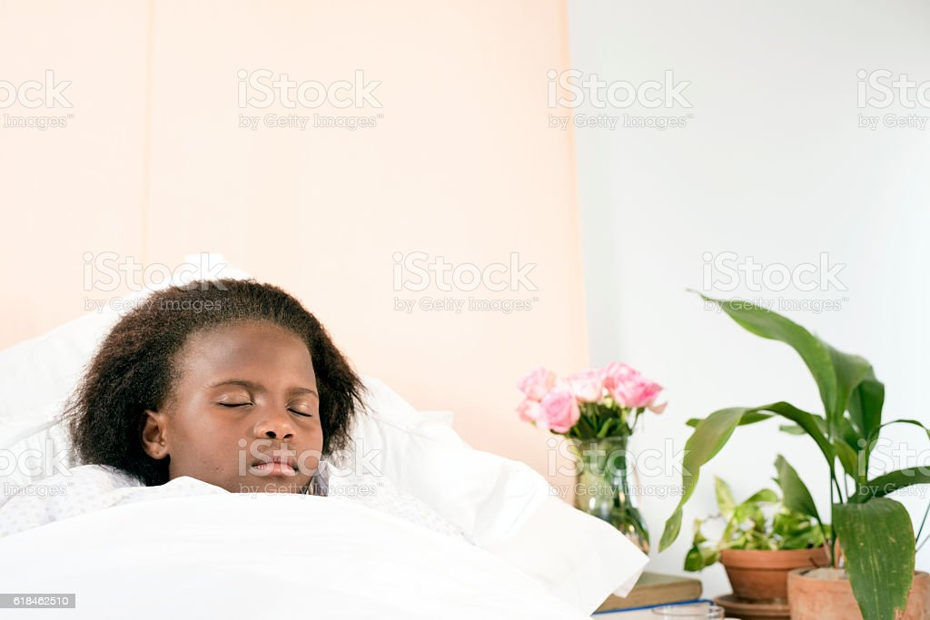 Small African Girl Asleep In Bed stock photo