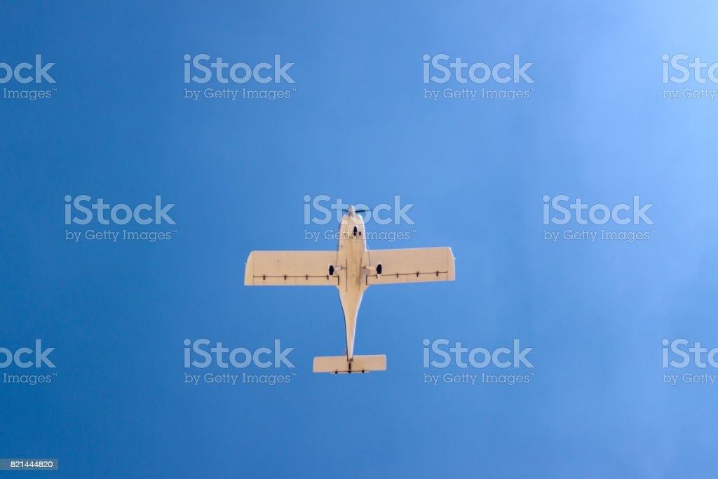 Small aircraft flying in sky stock photo