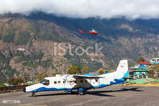 istock Small Airplane at Runway of small Airport in Himalaya Mountains 667777646