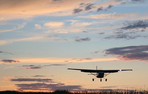 Small airplane at sunrise / sunset