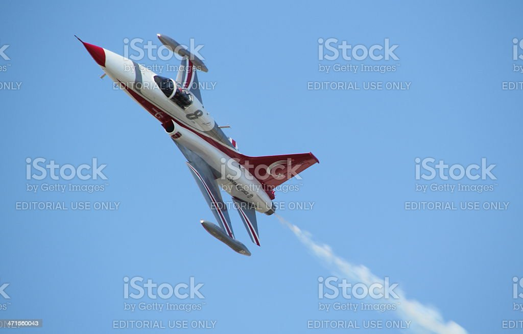 small airplane in the sky stock photo