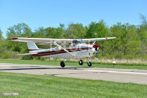 This is a Cessna Skyhawk single engine, piston-driven private airplane, landing at a small county airport.