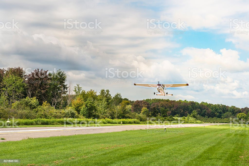 Small Airplane Taking Off into a Storm stock photo