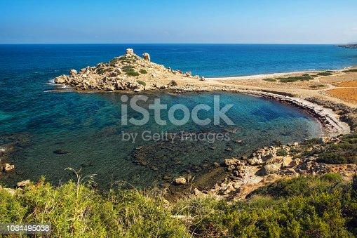 istock Small Alagadi beach panorama with peninsula and dry pasture 1084495038