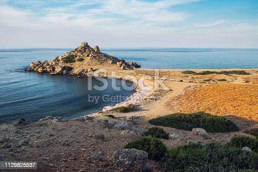 istock Small Alagadi beach panorama with peninsula and dry pasture with grazing sheep 1129825537