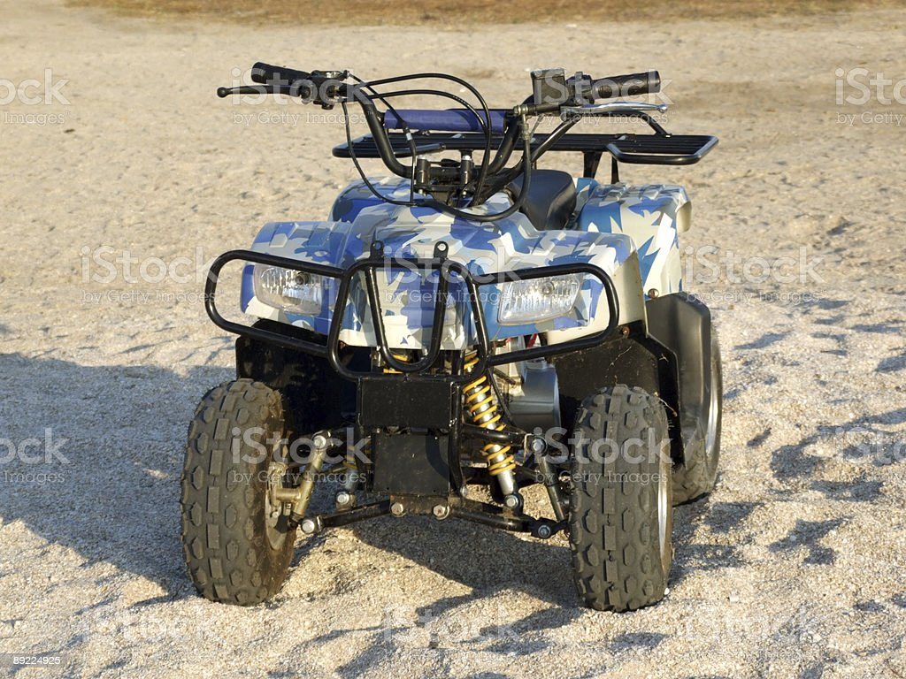 Small All Terrain Vehicle on a beach 2 stock photo