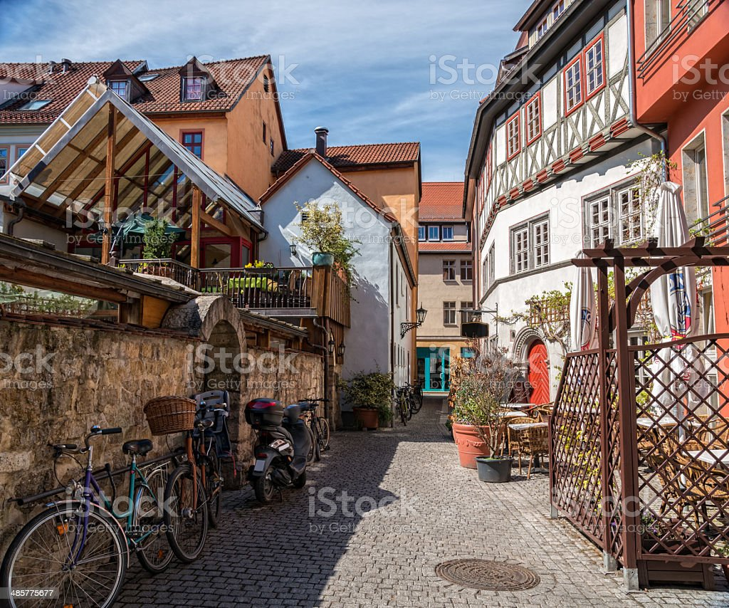 small alley with bicycles and restaurants stock photo