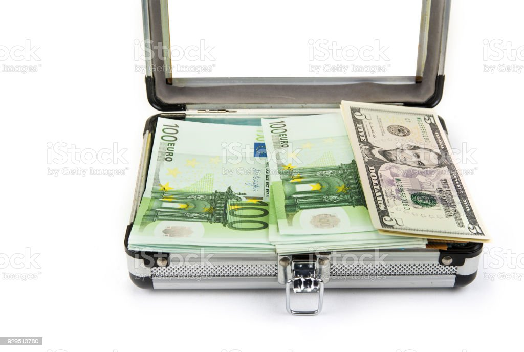 Small Aluminium Trunk Full Of Euros And Dollars Royalty Free Stock Photo