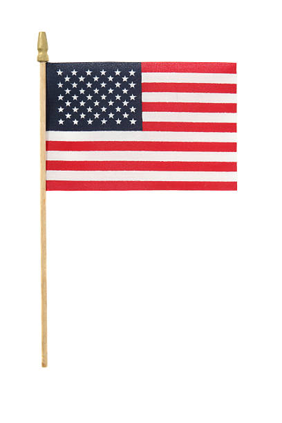 Small American flag on plastic stick on white background Small American flag on a stick, isolated on white small stock pictures, royalty-free photos & images