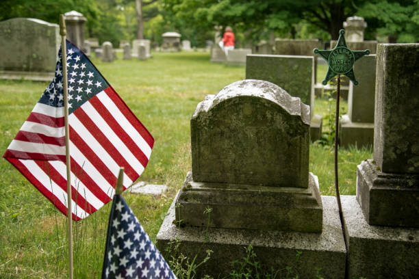 Small American flags and headstones in Boston MA stock photo