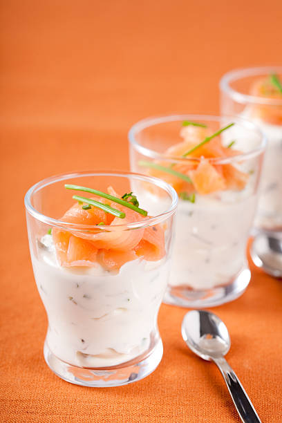 Small amuse bouche Amuse bouche in a glass with curd and smoked salmon amuse stock pictures, royalty-free photos & images