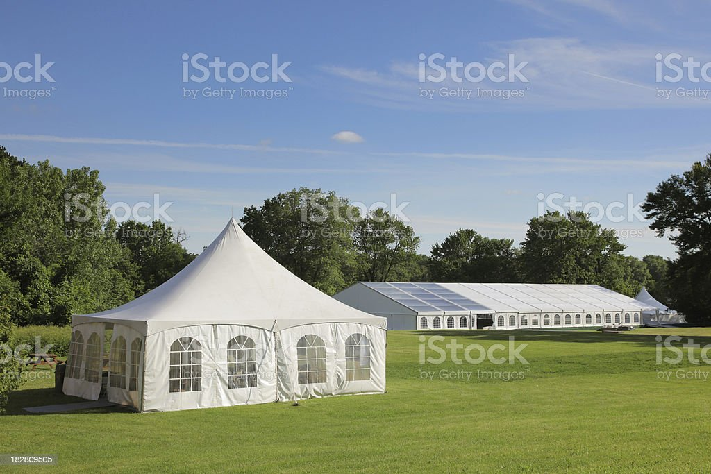 Small and large celebration tents in a park stock photo