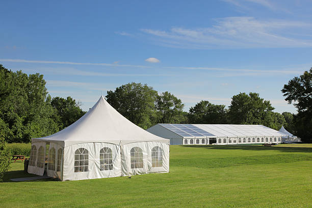 Small and large celebration tents in a park  tent stock pictures, royalty-free photos & images