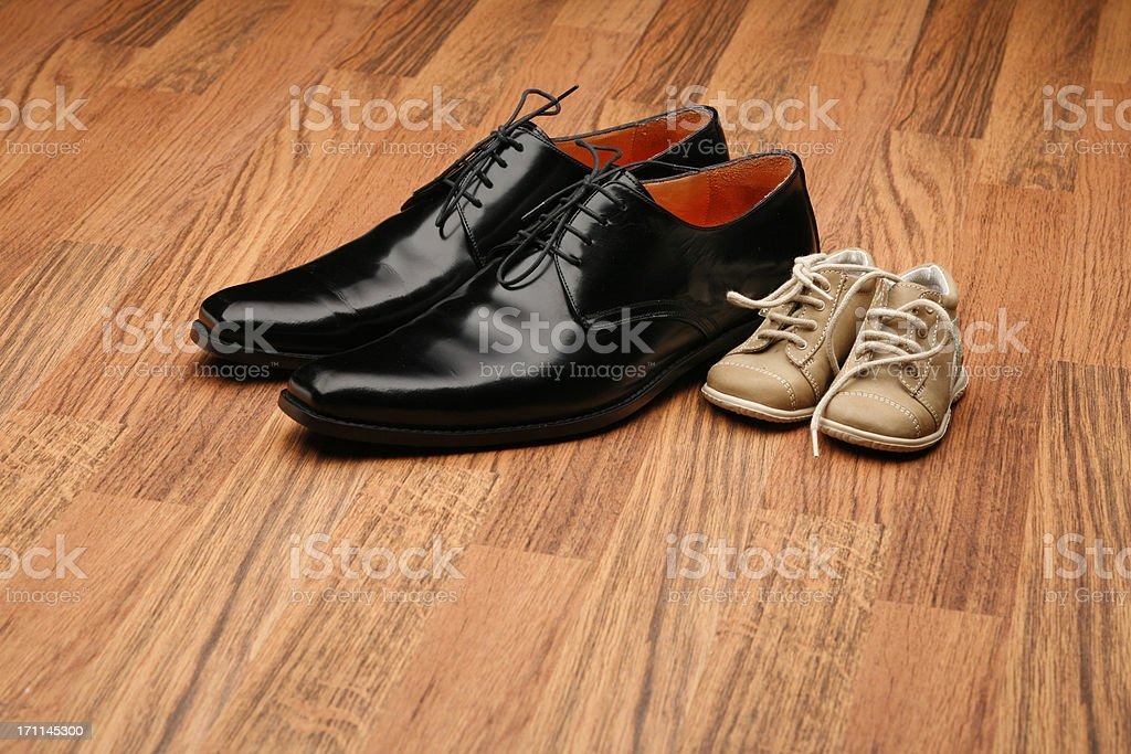 Small and large shoes stock photo