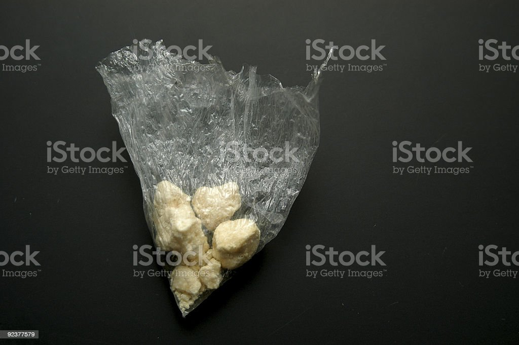 Small and medium crack stones on a ripped plastic bag royalty-free stock photo