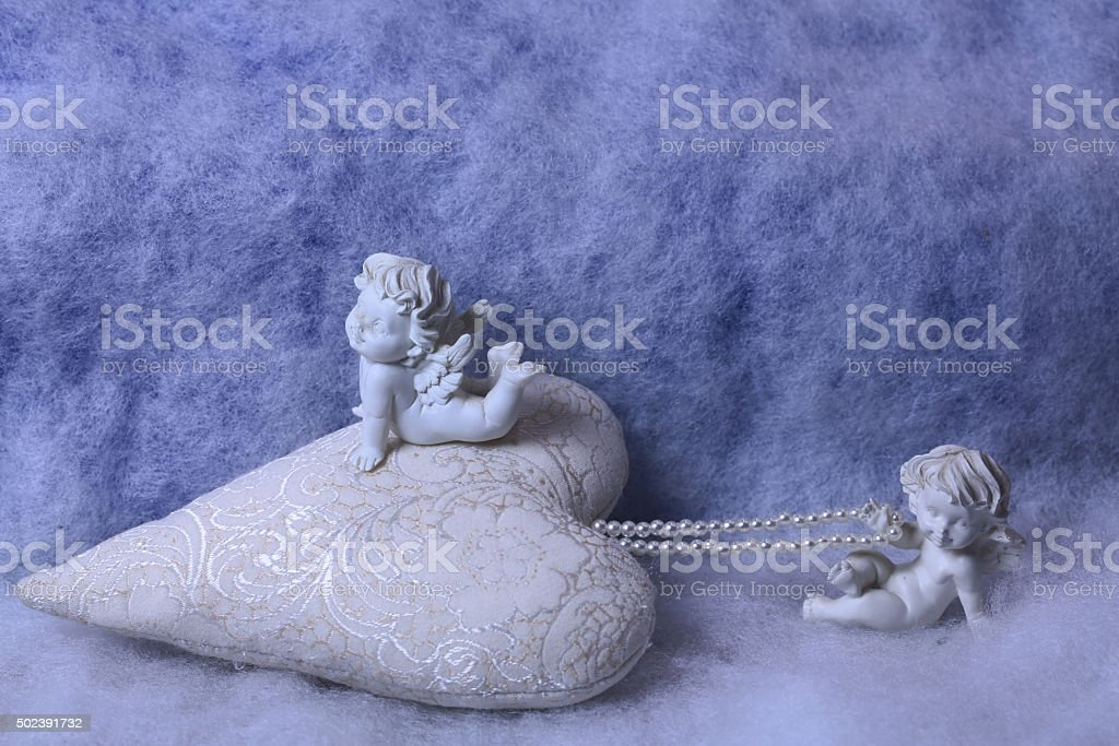 Small angel figurines stock photo