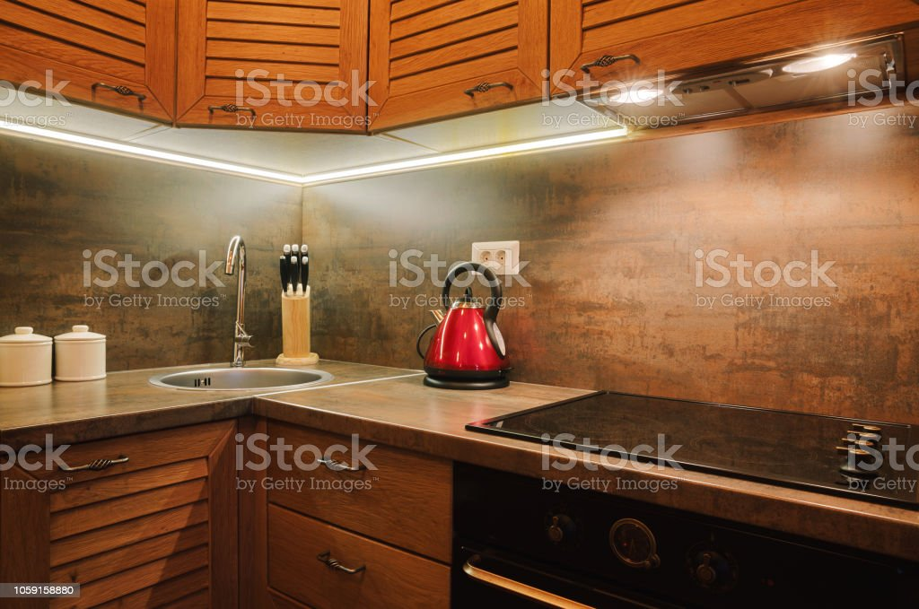 Interior of a small apartment, details of kitchen with brown wooden...