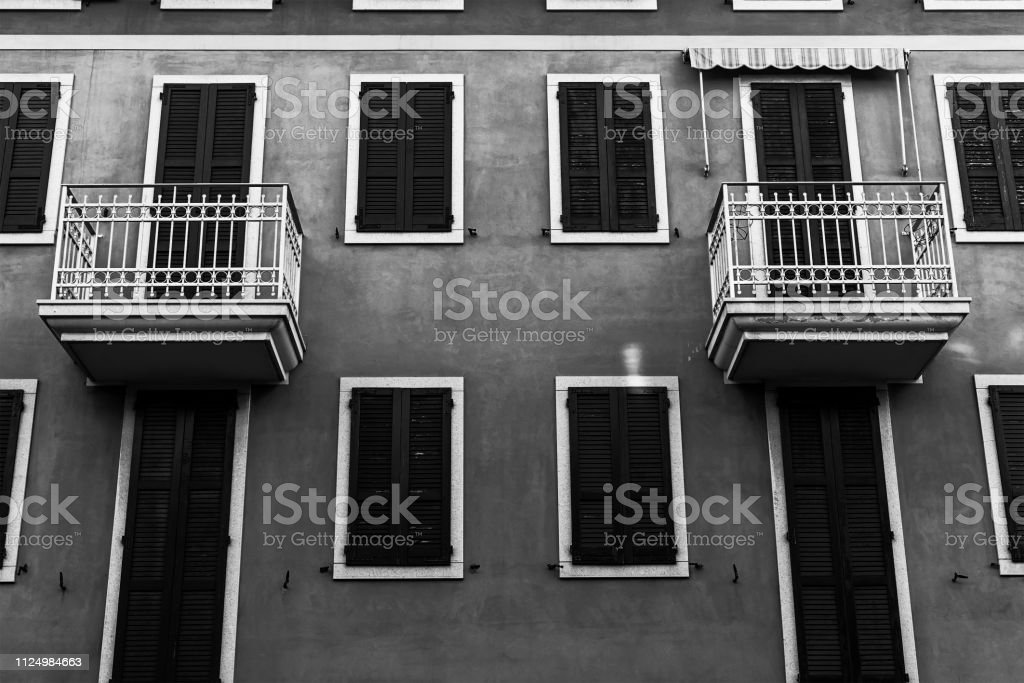 Small apartment rooms with identical balconies.