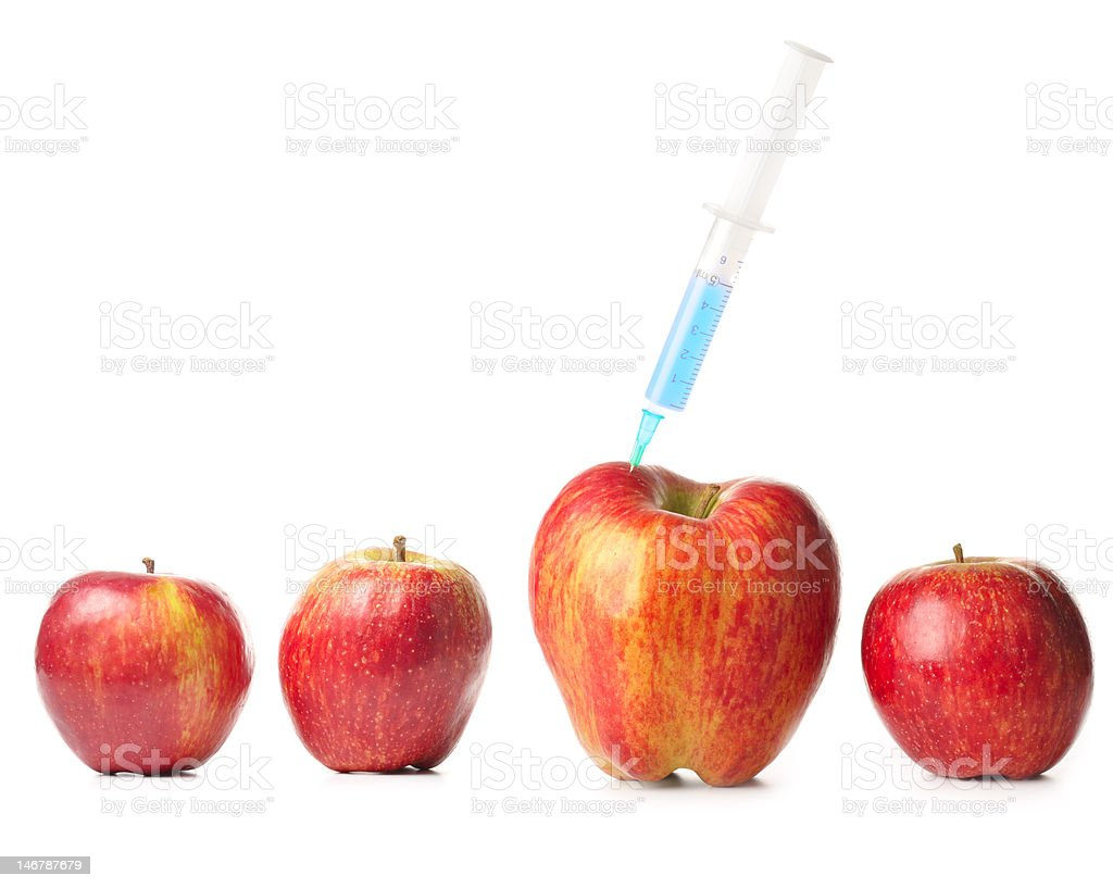 small apples and a big one with syringe royalty-free stock photo