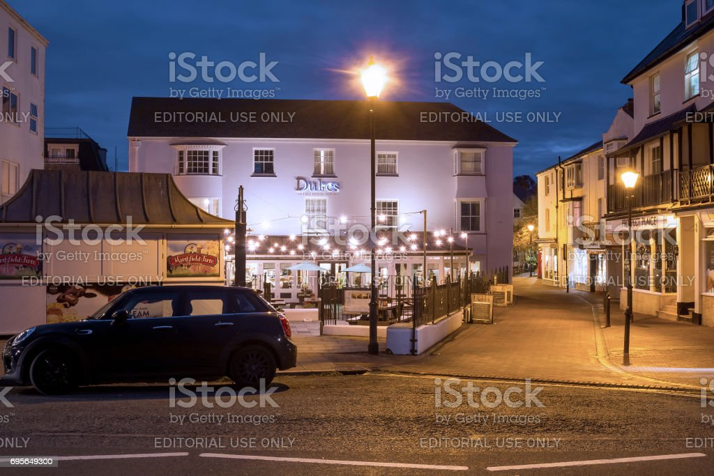 A small area with night lighting and car stock photo