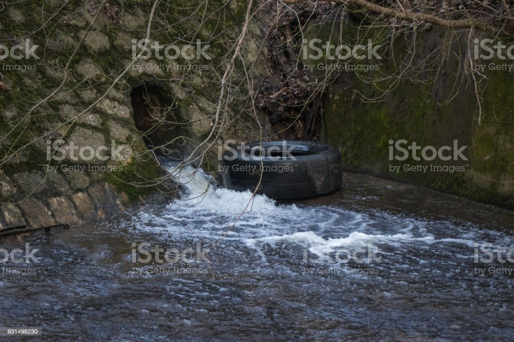 Small artificial water fall stock photo