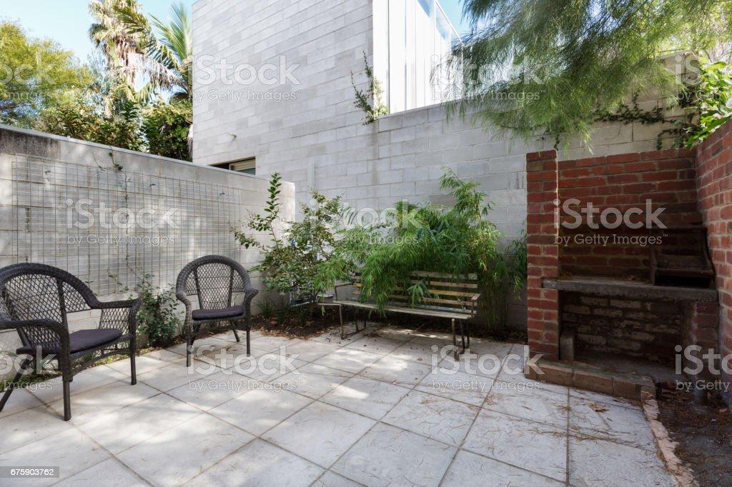 Small Australian apartment paved courtyard stock photo