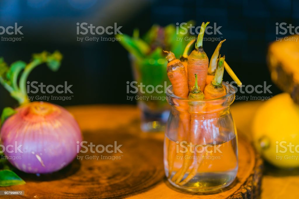 Small baby carrots in water on cutting board stock photo