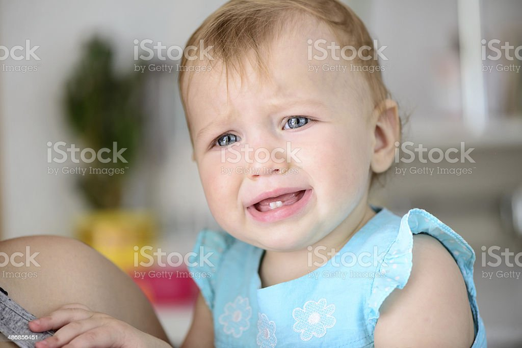 small baby crying stock photo