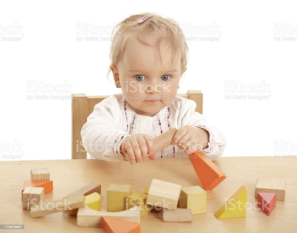 small baby girl with wooden blocks royalty-free stock photo