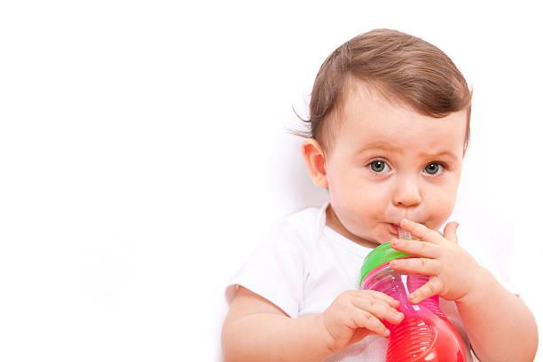 kleine baby - innocent saft stock-fotos und bilder