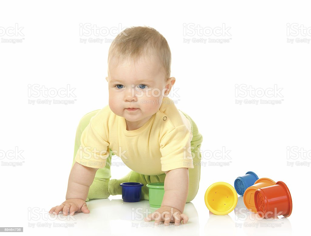 Small baby with toy pyramid isolated royalty-free stock photo