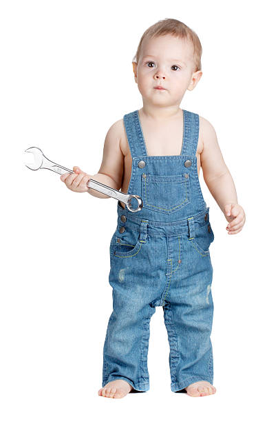 Small baby worker with spanner wrench stock photo