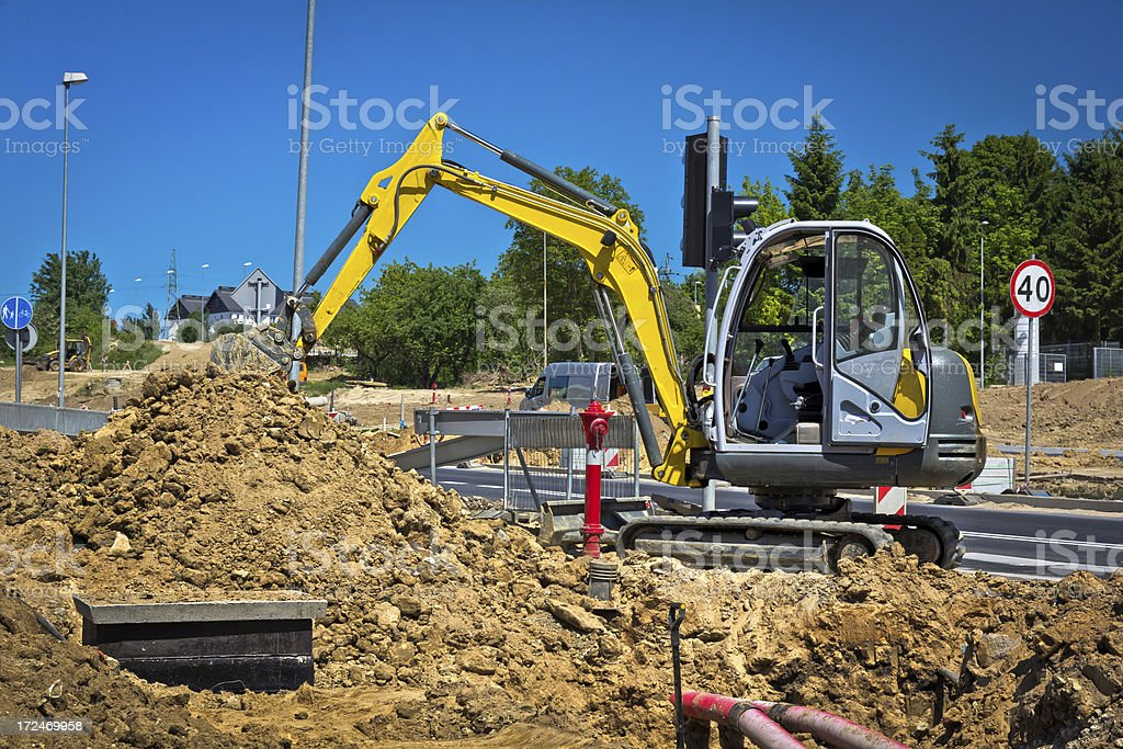 Small backhoe at work royalty-free stock photo