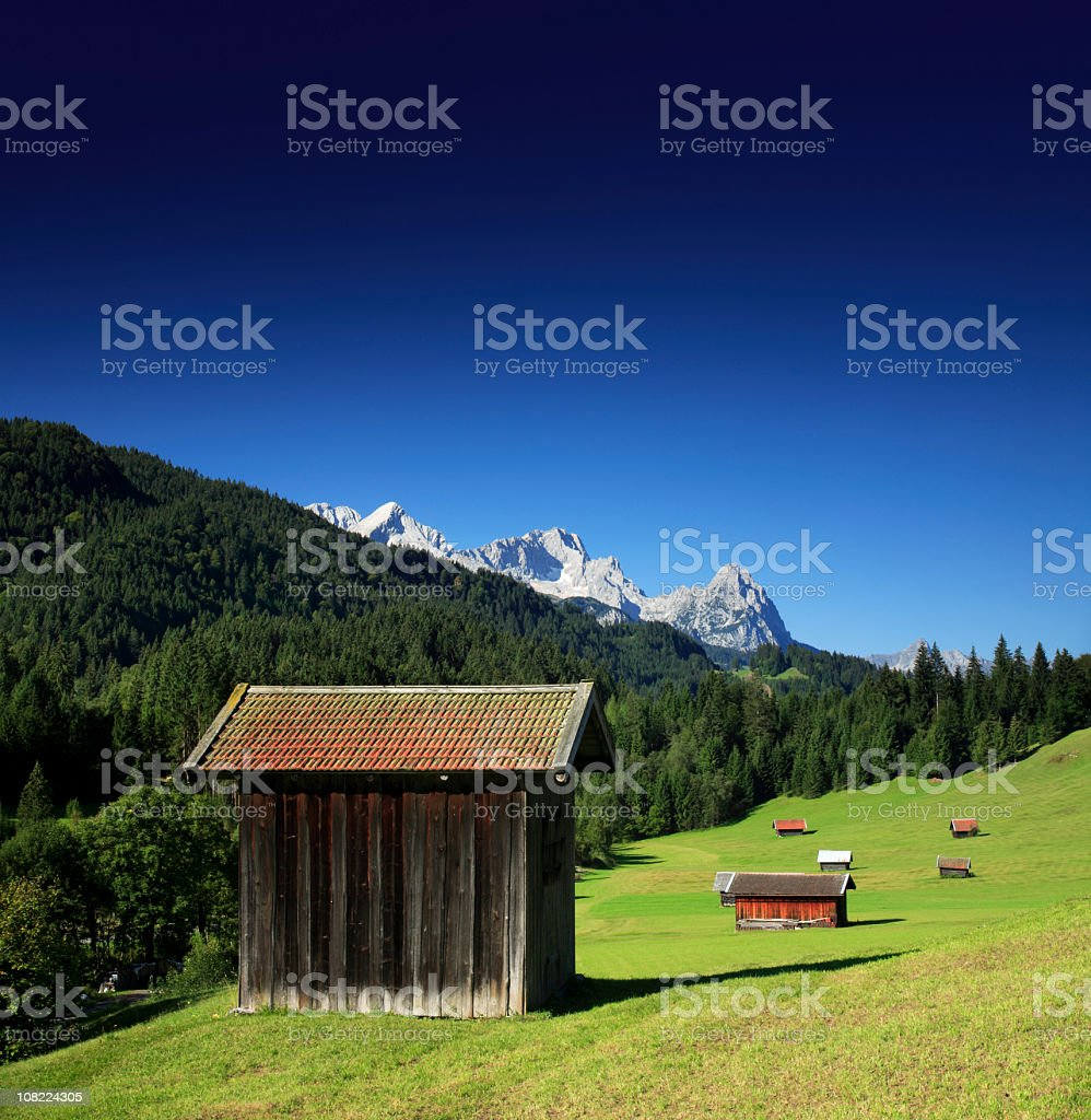 Small Barns in Bavarian Alps Field royalty-free stock photo
