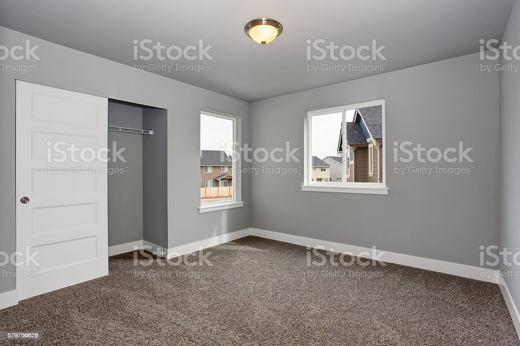 Small Basement Room Interior With Grey Walls And White Trim. Royalty Free  Stock Photo