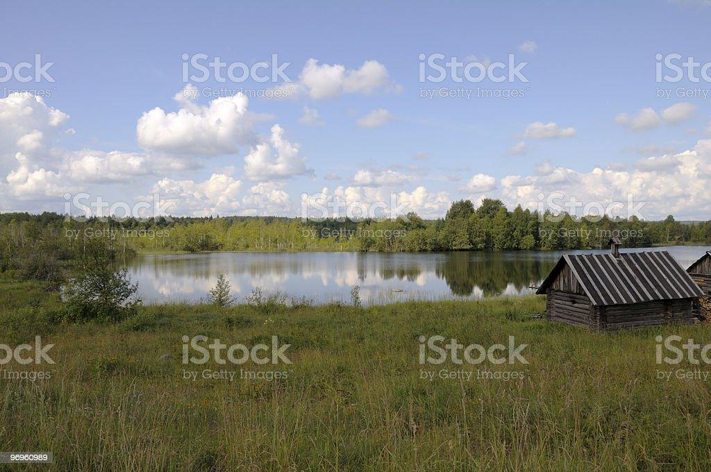 Small bathhouse on a lake shore royalty-free stock photo