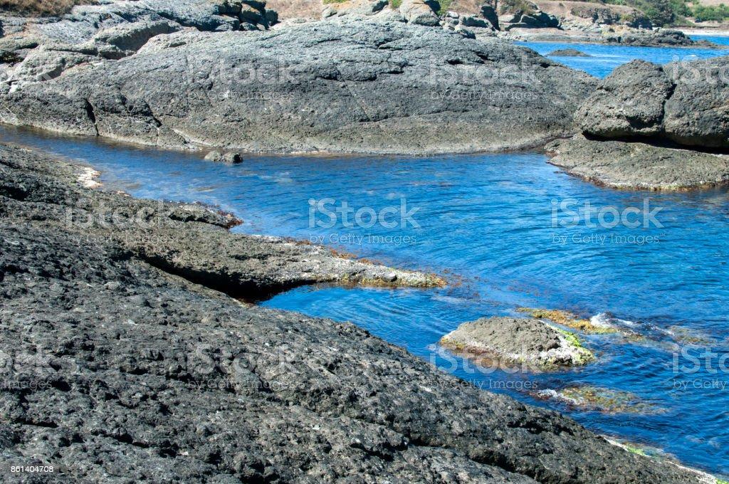 Small bay among rocks stock photo