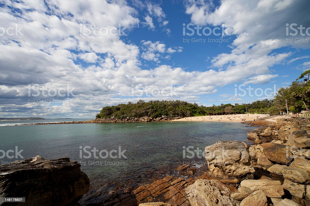 Small beach in a remote bay stock photo