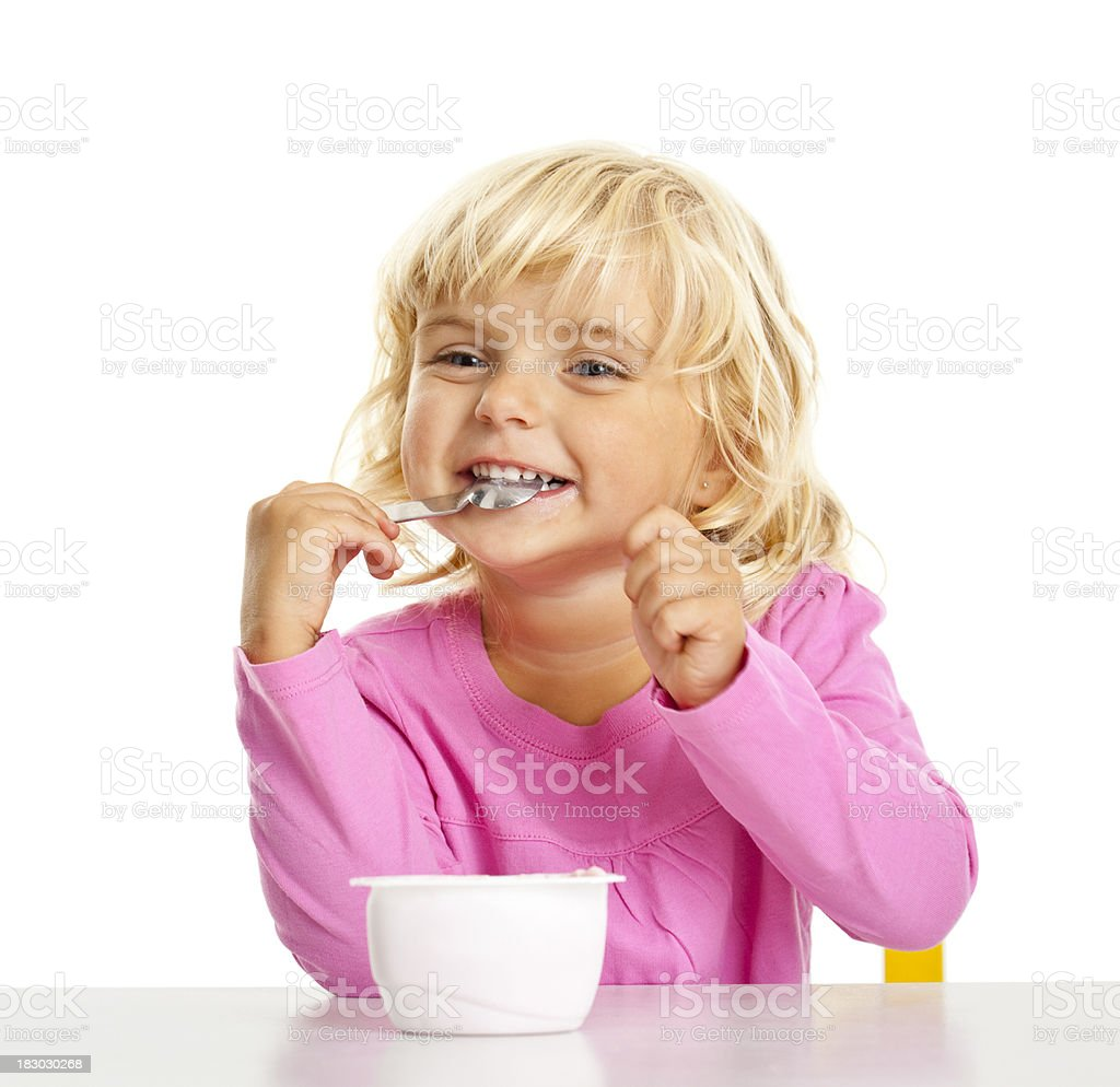 small beauty girl eating a yoghourt royalty-free stock photo