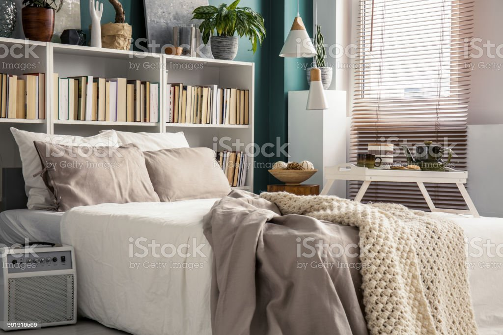 Small bedroom with designer decor stock photo