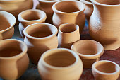 Small beige clay pots, background, texture, for any purpose