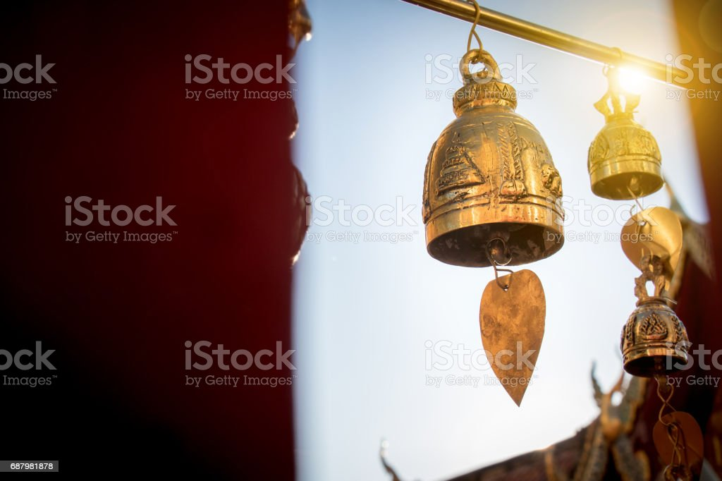 Small bell for pray decorate around Thai buddha temple with sunrise at Doi suthep landmark  for tourist in Chiang Mai province , Thailand stock photo