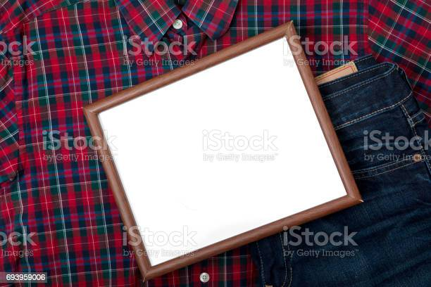 Top view of a blank whiteboard with a pant and shirt for father, concept of father's day