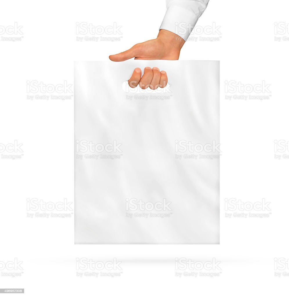 Small blank plastic bag mock up holding in hand. stock photo
