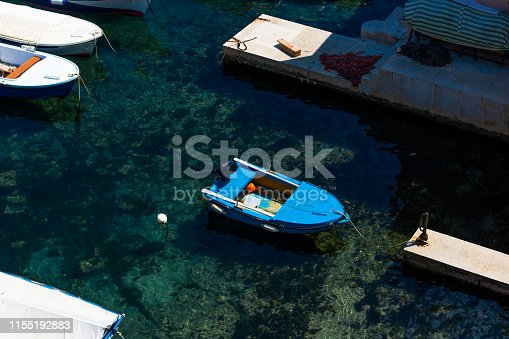 View at small blue boat moored in a marina in Old Town of Dubrovnik.