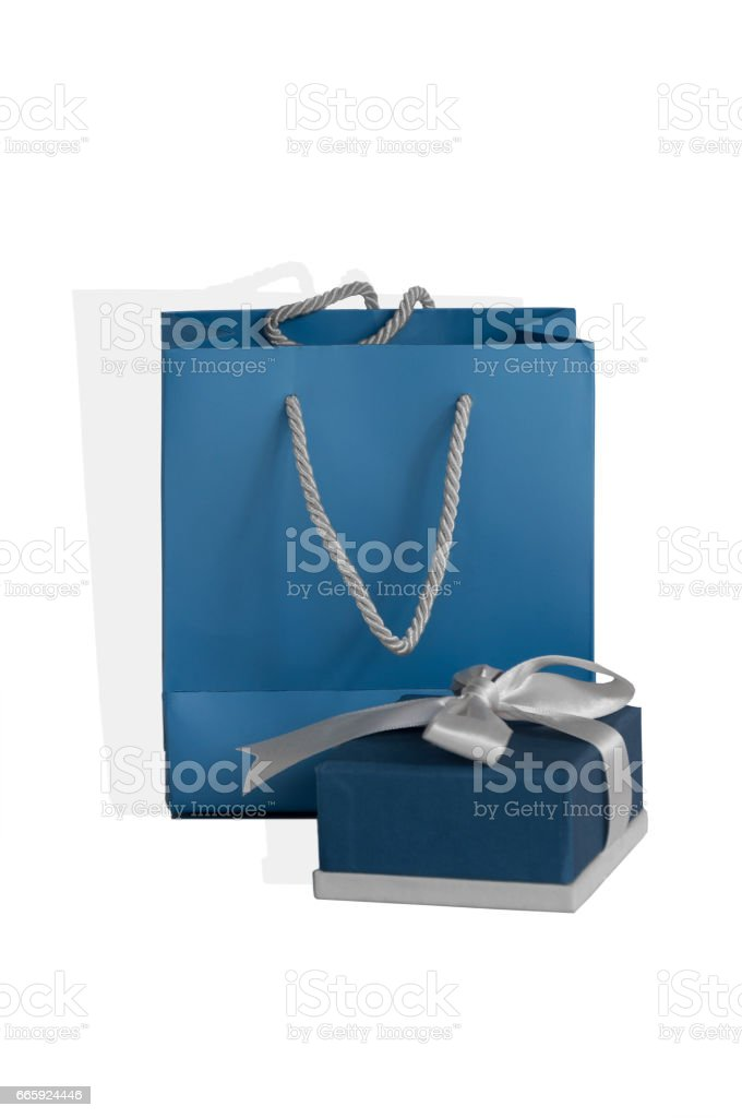small blue box tied with a silver ribbon and gift paper-bag as a set stock photo
