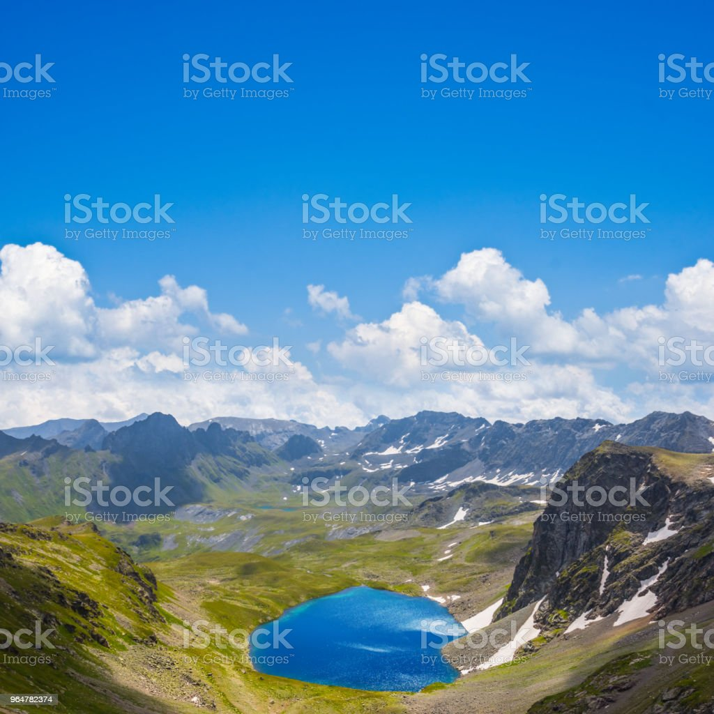 small blue lake in a mountain valley bowl royalty-free stock photo
