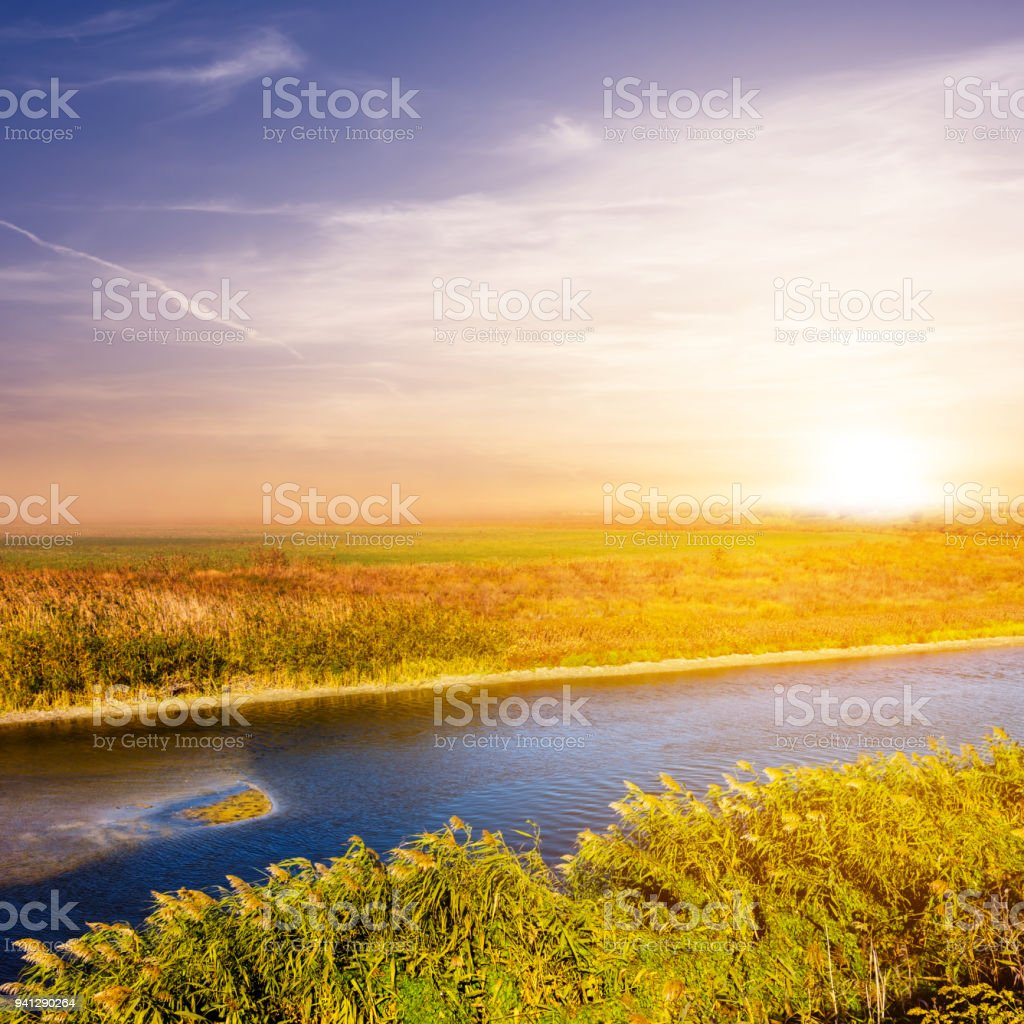 small blue rural river at the sunset stock photo